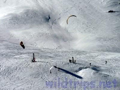 Ski and snow: snowboarding with a kite in the Italian Alps