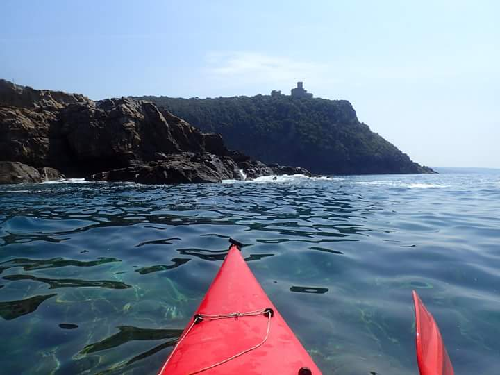 Kayaking towards the castle of Sonnino, Tuscany